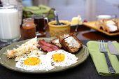 pic of hash  - Eggs sunny side up with hash browns bacon strips and banana bread for breakfast - JPG