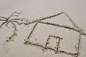 House and Palm Tree Drawn in the Sand