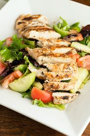 picture of cucumbers  - Freshly prepared grilled chicken chef style salad with tomato cucumber green pepper and romaine lettuce - JPG