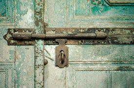 foto of barn house  - Rusted keyhole on wooden door  - JPG
