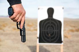 foto of handgun  - Target shooting with handgun on remote location - JPG