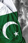 stock photo of pakistani flag  - Pakistani waving flag on a bad day - JPG