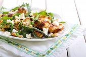 foto of rocket salad  - Zucchini rocket feta and nut salad on plate - JPG