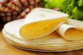 pic of whole-wheat  - stack of homemade whole wheat flour tortillas on a wooden table - JPG