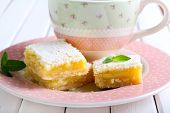 picture of icing  - Tangy lemon squares with icing sugar and cup of coffee - JPG