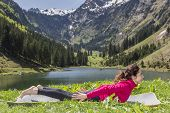 image of locusts  - Caucasian woman doing locust pose in yoga outdoors in nature - JPG