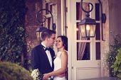 picture of windows doors  - Bride and groom near door with windows - JPG