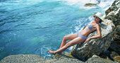 picture of sunbather  - Young pretty woman on the beach sunbathing. Summer travel. Sea - water wellbeing.