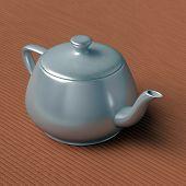 stock photo of teapot  - teapot on a bamboo mat - JPG