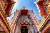 picture of buddhist  - Dynamic view the Wat Chalong Buddhist temple entrance in Chalong - JPG