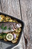 pic of baked potato  - Baked trout with potatoes and onions sprinkled with parsley - JPG