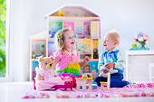 image of twin baby girls  - Kids playing with doll house and stuffed animal toys - JPG