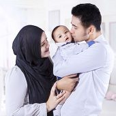 pic of muslim kids  - Portrait of happy muslim parents with their 0 - JPG