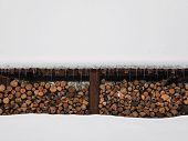 picture of icicle  - Huge woodpile neatly stacked unter snow - JPG