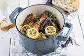 stock photo of pot roast  - Lavender Chicken in Nordic Style Pot - JPG
