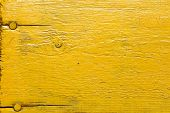picture of nail paint  - Painted yellow wooden desk with nails as a texture - JPG