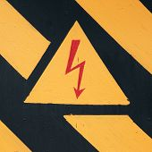 pic of substation  - warning symbol on old doors of the transformer substation - JPG