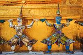 stock photo of buddha  - Giant Buddha in Wat Phra Kaeo Temple of the Emerald Buddha in Bangkok Thailand - JPG