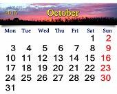 stock photo of october  - calendar for October 2016 with crimson sunset - JPG