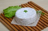 foto of brie cheese  - Camembert brie cheese with herbs on the wood background - JPG