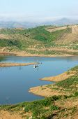 stock photo of mountain chain  - Vietnam countryside landscape impression chain of mountain cover Nam Ka lake bare hill from deforestation amazing scene with floating house on river residential on water - JPG
