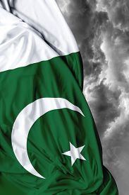 picture of pakistani flag  - Pakistani waving flag on a bad day - JPG
