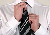 Business Man Adjusting Tie