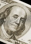Ben Franklin Portrait from Hundred Dollar Bill of American Currency, narrow focus on eyes.