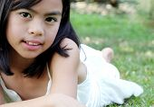 Asian Child Outdoors poster