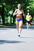 young woman run marathon and recreating fitness sport