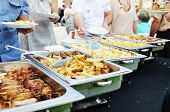 stock photo of catering  - people choosing food from table on catering and buffet party on business seminar conference or wedding - JPG