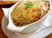 Lasagna in baking dish Italian cuisine melted cheese