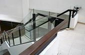 Modern glass and steel staircase bright airy