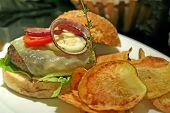 Gourmet hamburger with chips elegant presentation in a restaurant
