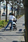 Mother Rollerblade In Park