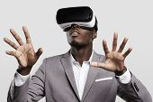 Technology, Gaming, Entertainment And People Concept. African Man Wearing Formal Suit And Virtual Re poster