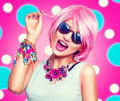 Beauty teenage model girl with pink hair, fashion colorful accessories and sunglasses over bright po poster