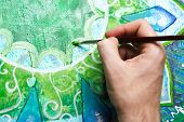 Closeup Of Man Painting Green Picture With Circle Pattern, Mandala Of Anahata Chakra