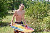 Male Teen Skimboard
