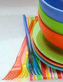 colorful plastic tableware  and napkins
