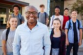 Portrait Of High School Students With Teacher Outside College Buildings poster