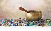 Tibetan Singing Bowl Surrounded By Tumbled Healing Stones - Brass Tibetan Singing Bowl With Mallet   poster