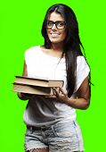 portrait of young woman holding a books pile against a removable chroma key background