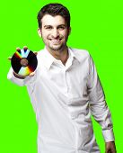 portrait of young man holding cd against a removable chroma key background
