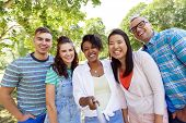 people, friendship and international concept - happy smiling young woman and group of happy friends  poster