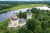 Birds eye view of the Vazhinka river and Orthodox Church Of The Resurrection. Kurpovo village in Va poster