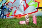 A Few Used Paint Cans Against The Background Of The Space With The Wall On Which The Young Guy Draws poster