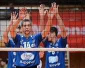 KAPOSVAR, HUNGARY - OCTOBER 29: Roland Vajda (14) in action at a Hungarian National Championship volleyball game Kaposvar (blue) vs. Szolnok (red), October 29, 2011 in Kaposvar, Hungary.