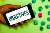 Conceptual Hand Writing Showing Objectives. Business Photo Text Goals Planned To Be Achieved Desired poster