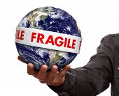 Earth wrapped in fragile tape concept for environmental awareness, conservation and protection Earth image courtesy of Nasa at http://earthobservatory.nasa.gov
